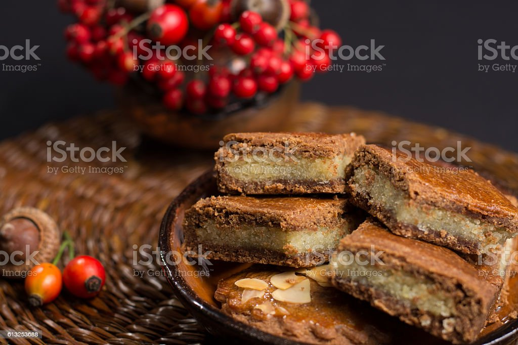 Typical Dutch filled spicy  cookies with almonds in autumn colors stock photo