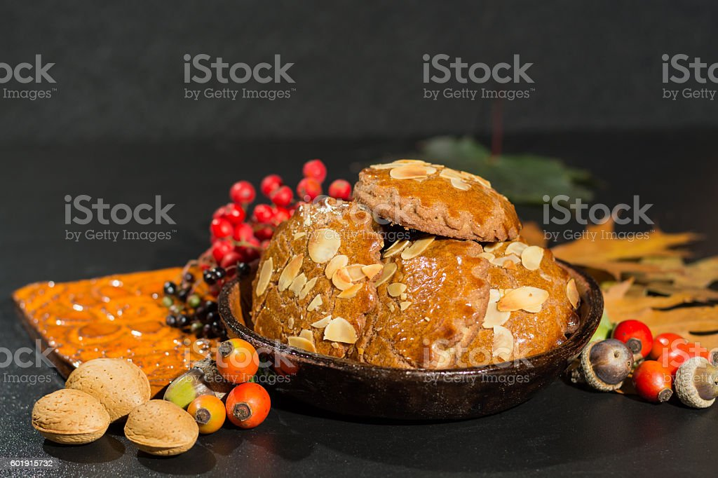Typical Dutch filled spicy  cookies with almonds on autumn color stock photo