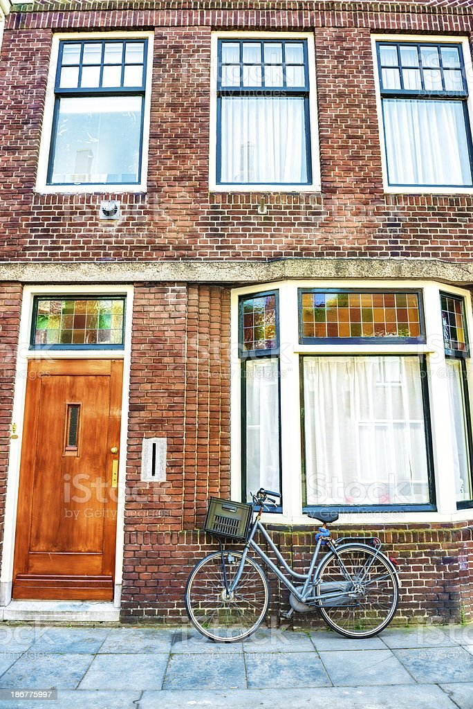 Typical Dutch Neighborhood With Traditional House and Bike royalty-free stock photo