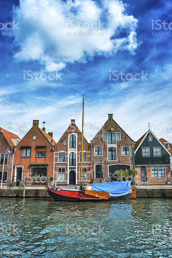 Typical Dutch Scene With Water Canal and Traditional Houses royalty-free stock photo