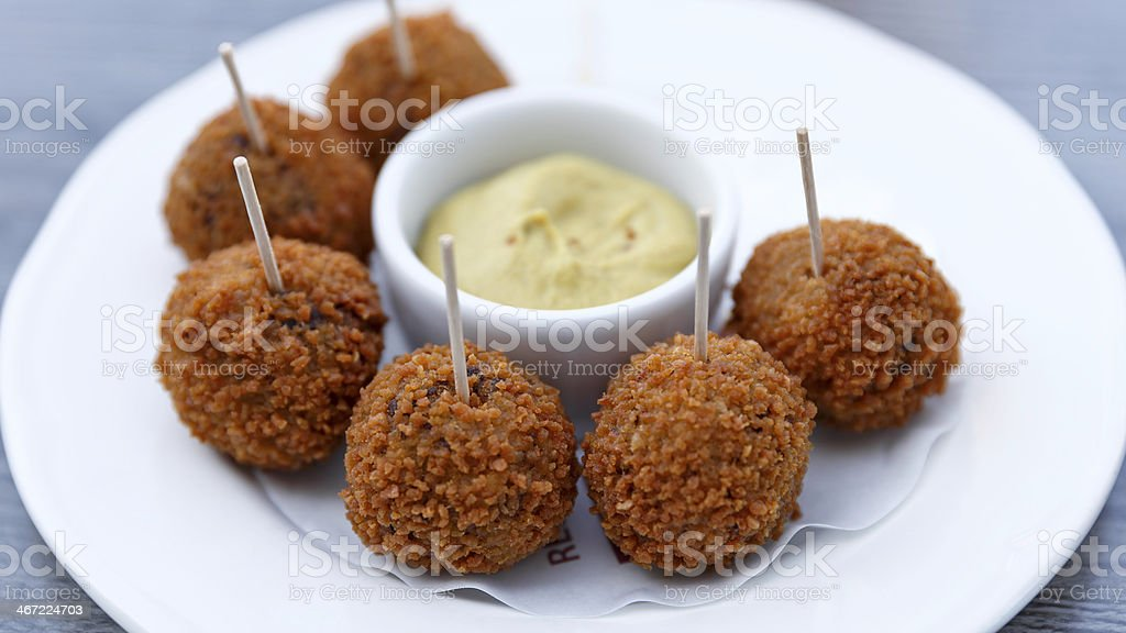 Typical Dutch snack : Bitterballen with mustard on white plate stock photo