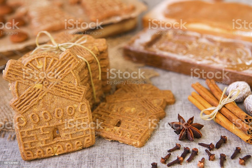 Typical Dutch speculaas cookies with authentic wooden cookie cutters stock photo