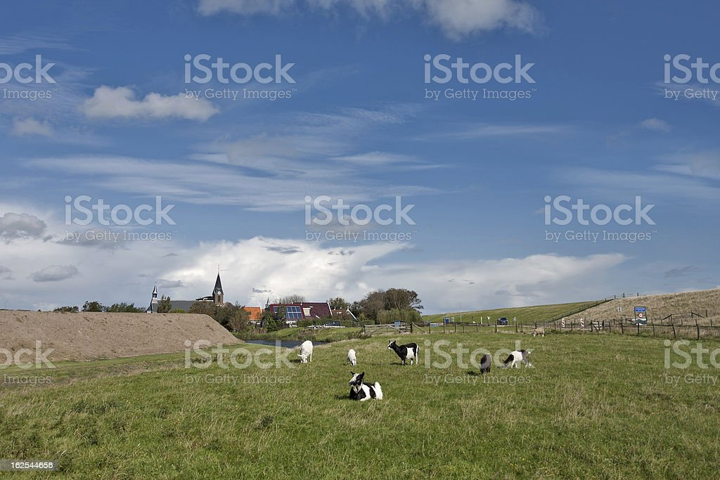 Typical Dutch village view behind the dikes stock photo