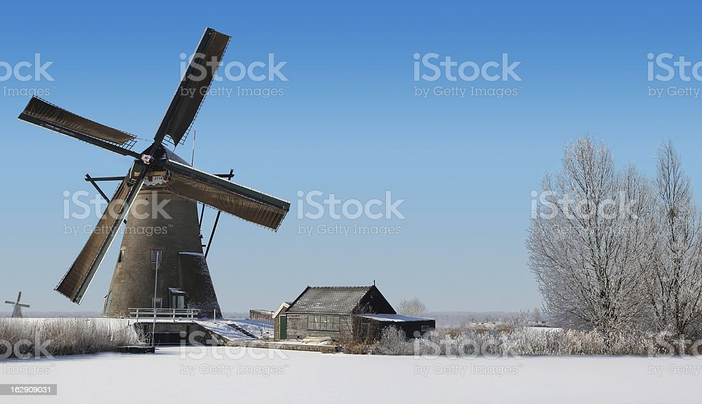 Typical dutch windmill and an old shack in the winter royalty-free stock photo