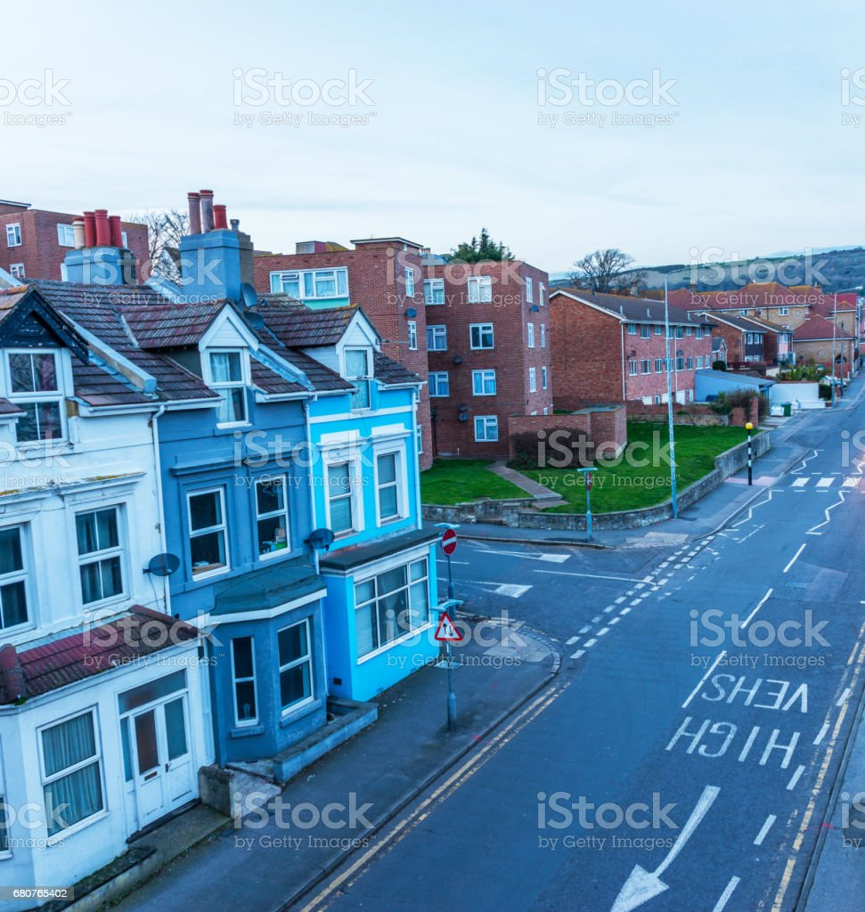 Typical English architecture, residential buildings in a row along the street, afternoon time of the day stock photo