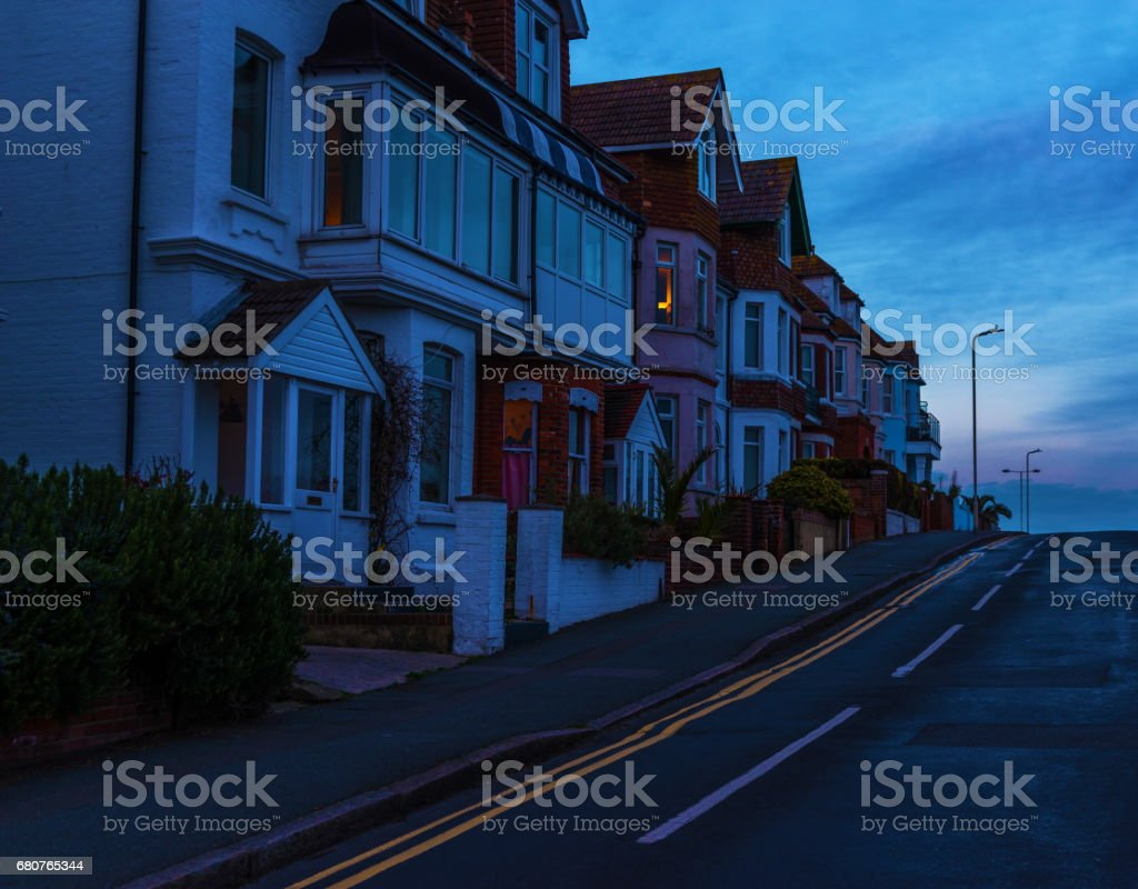 Typical English architecture, residential buildings in line along the street, beautiful sunset, stock photo