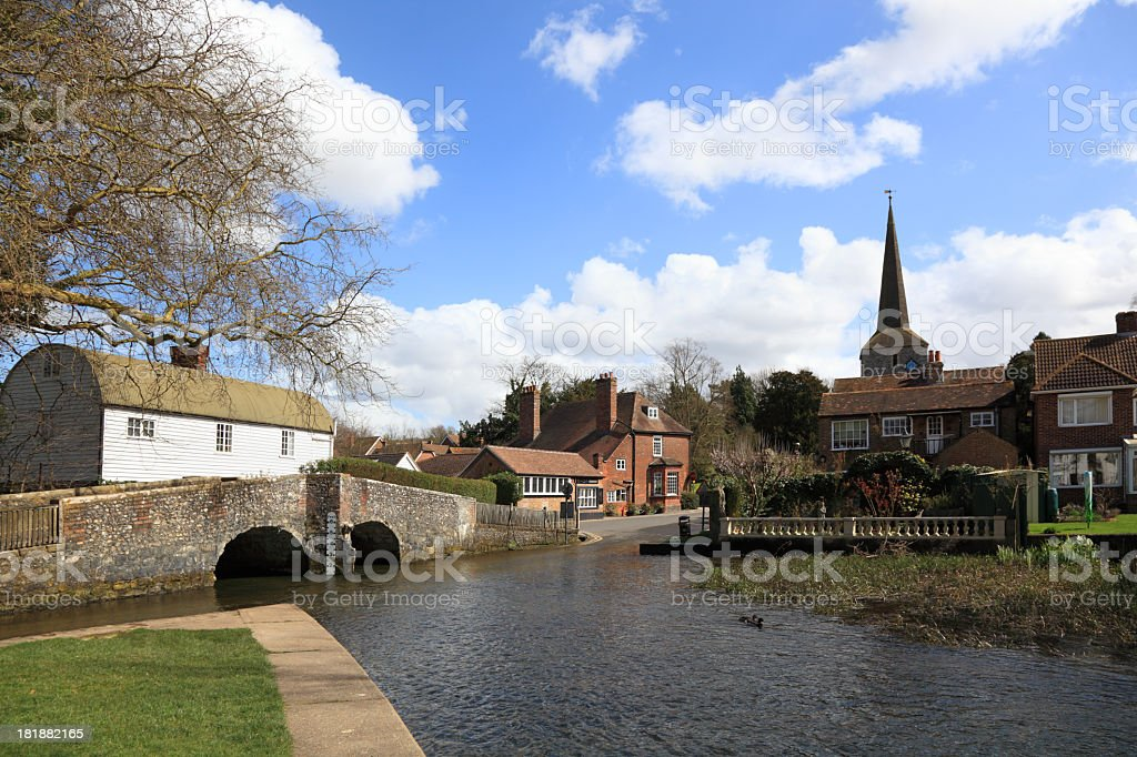 typical english village with ford bridge and church stock photo