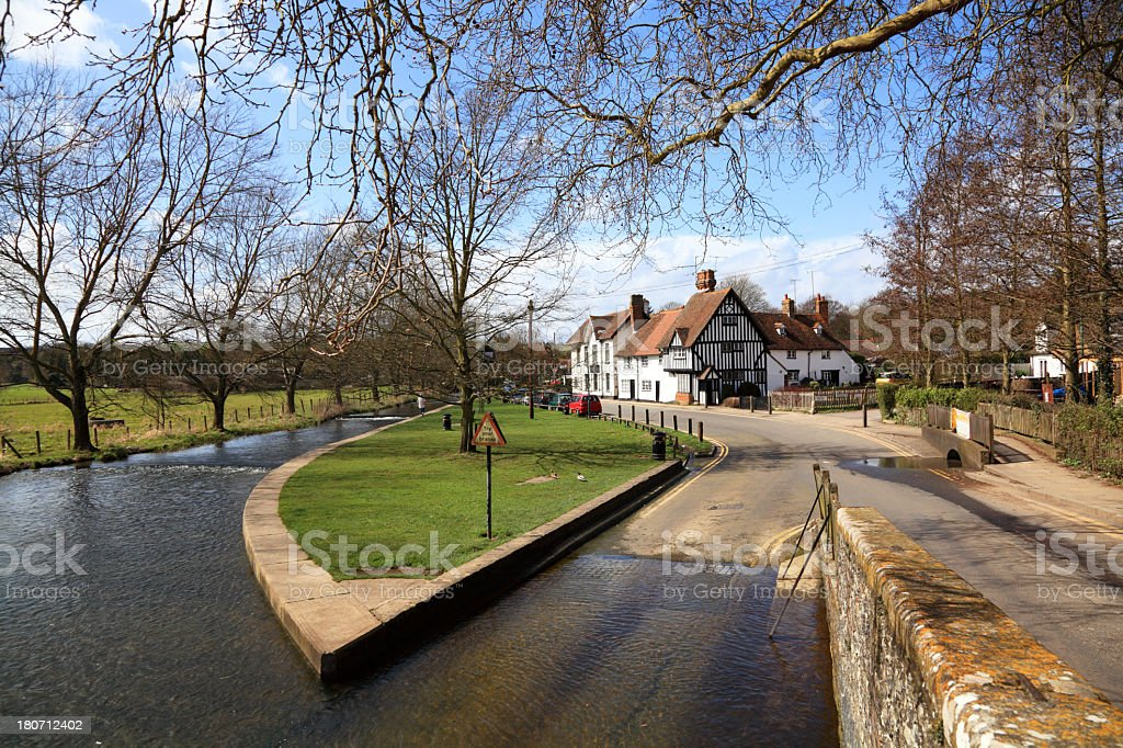typical english village with river ford bridge and old houses stock photo