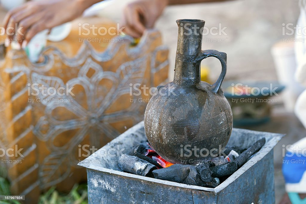 Typical Ethiopian boiling pot in a traditional coffee ceremony royalty-free stock photo