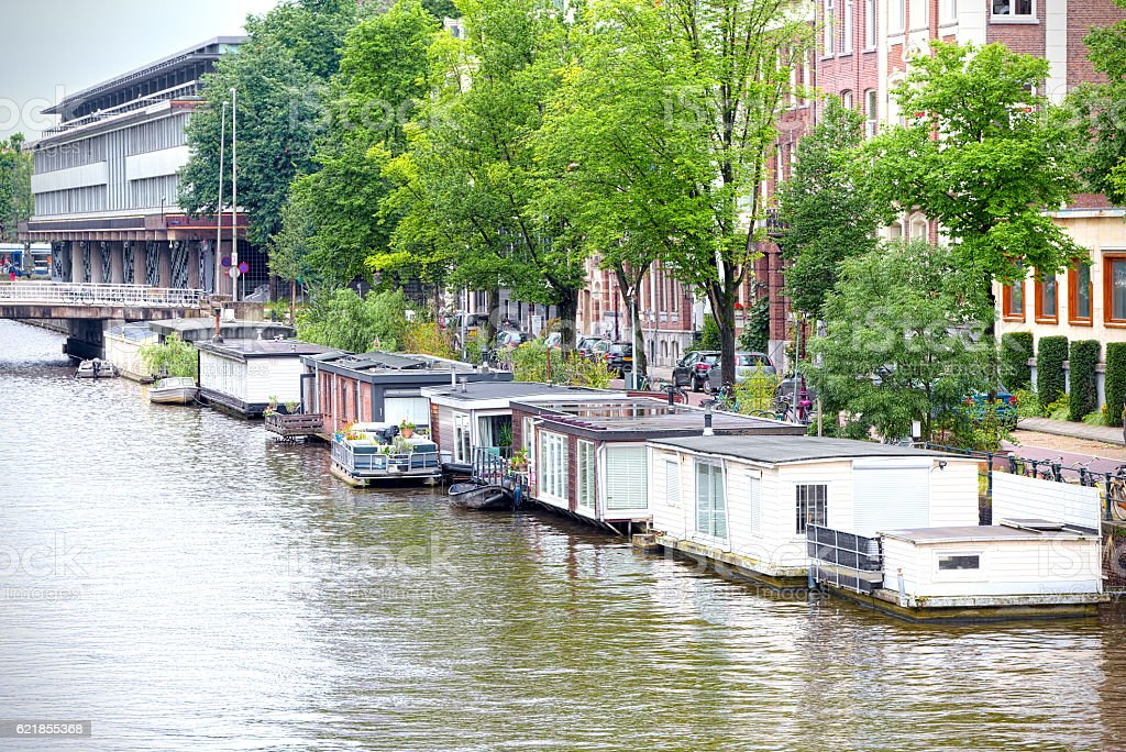 Typical floating wooden houses in Amsterdam stock photo