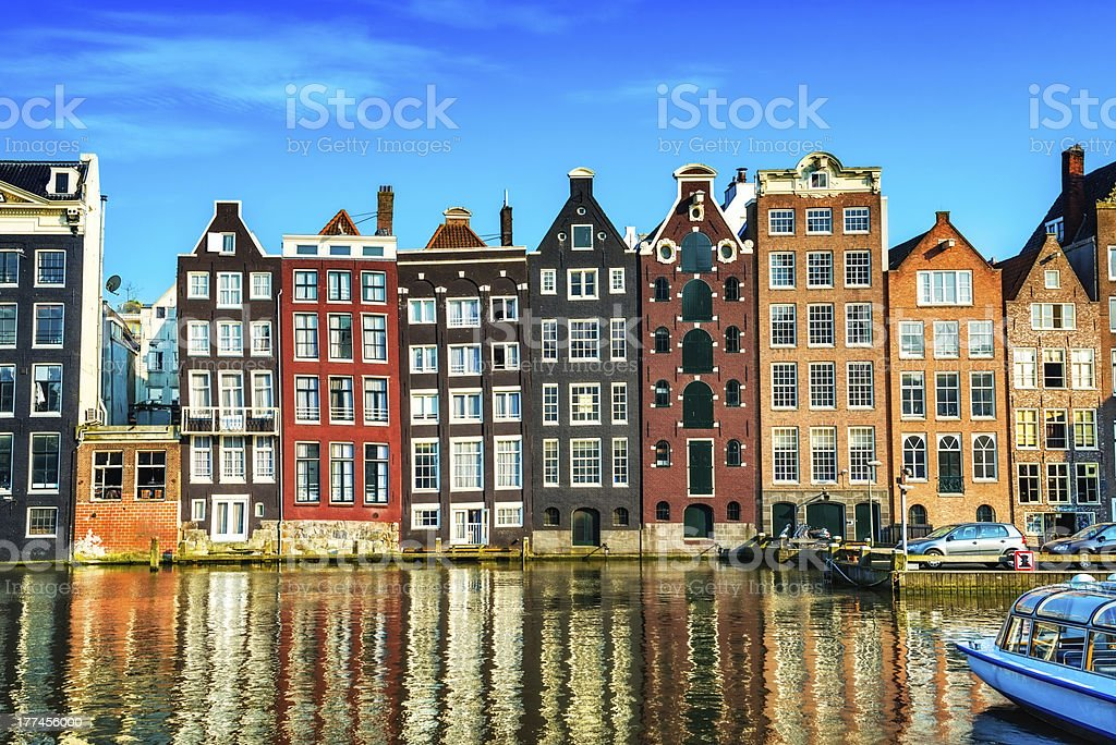 Typical gabled Dutch houses on a canal in central Amsterdam stock photo