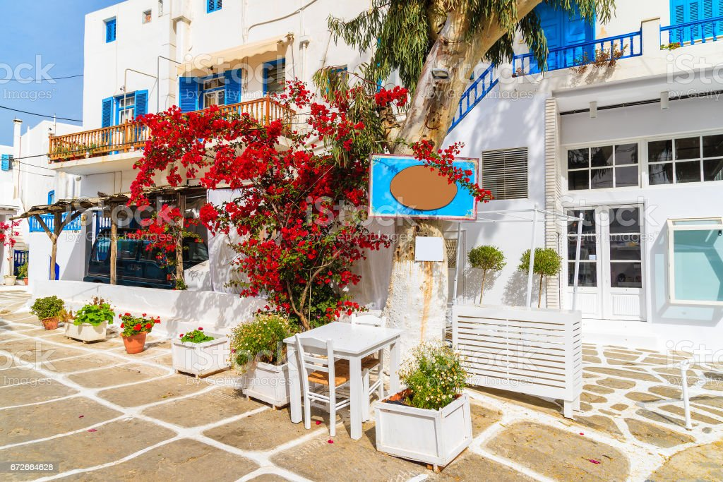 Typical houses decorated with flowers in Mykonos town on island of Mykonos, Cyclades, Greece stock photo