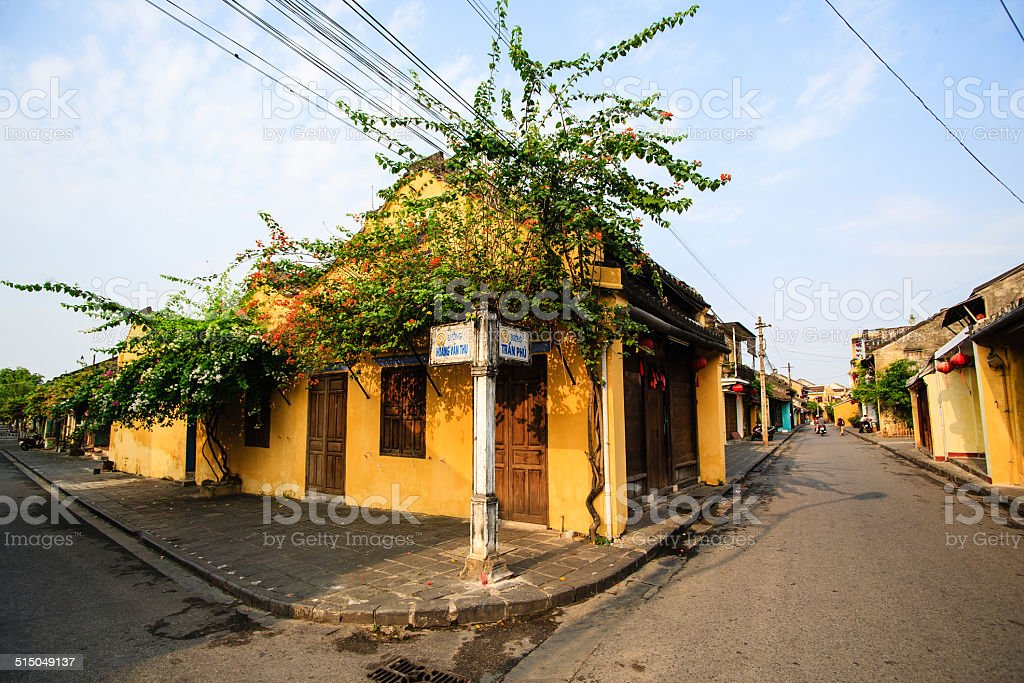 Typical houses with yellow wall and roof tiles, Hoi An stock photo
