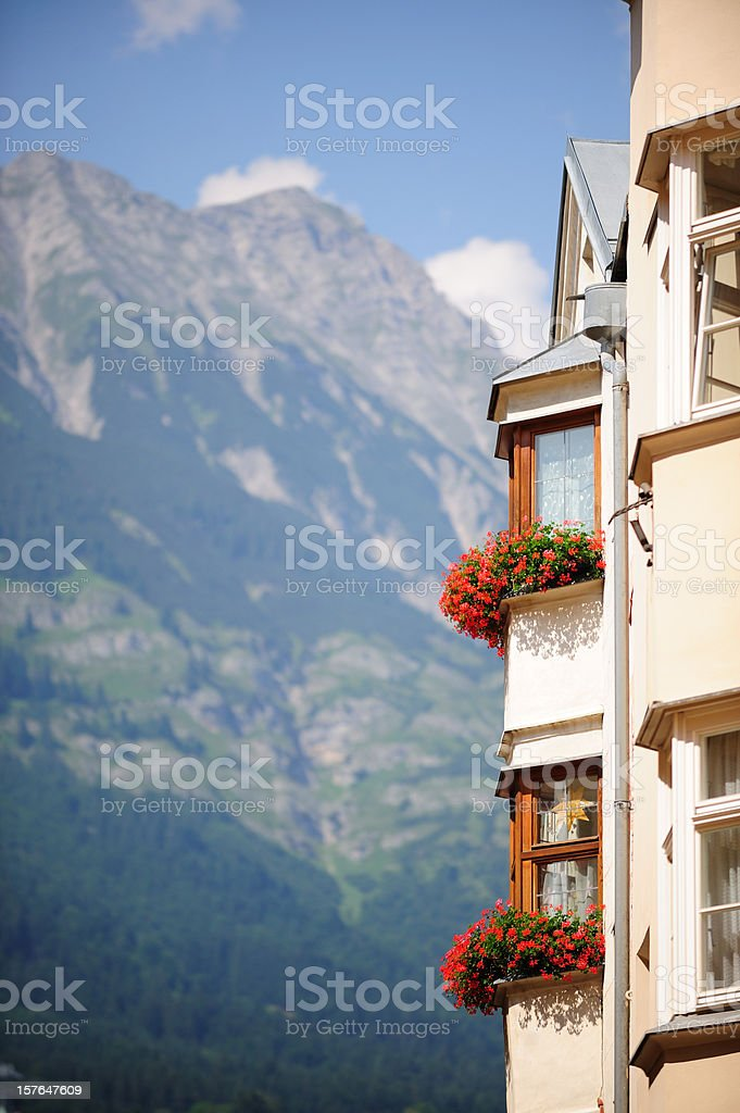 Typical Innsbruck balcony, mountains in background royalty-free stock photo