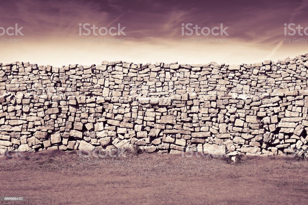 Typical Irish wall to divide pastures (Ireland) - toned image stock photo