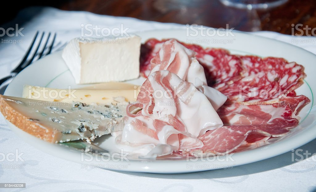 Typical Italian appetizer based charcuterie: coppa, salami, ham stock photo