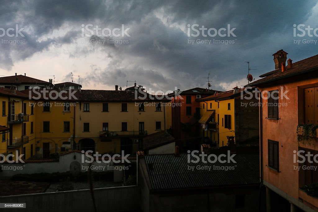 Typical italian courtyard under storm clouds stock photo