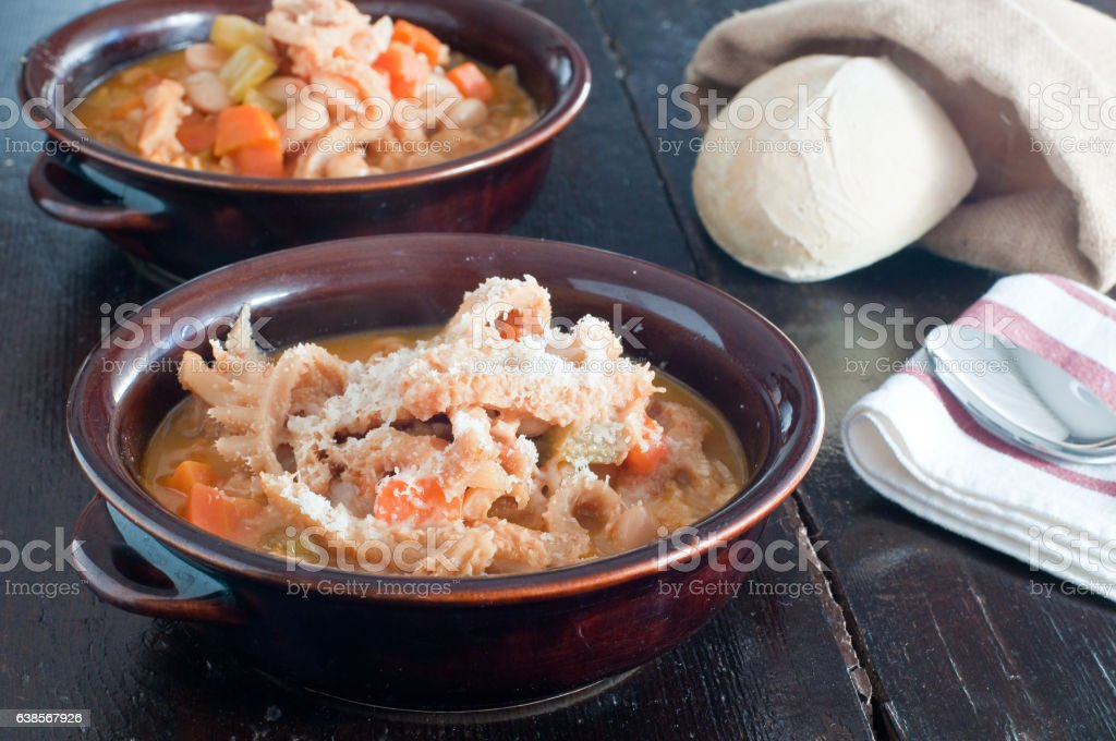 typical Italian dish tripe with beans, potatoes and veal stock photo