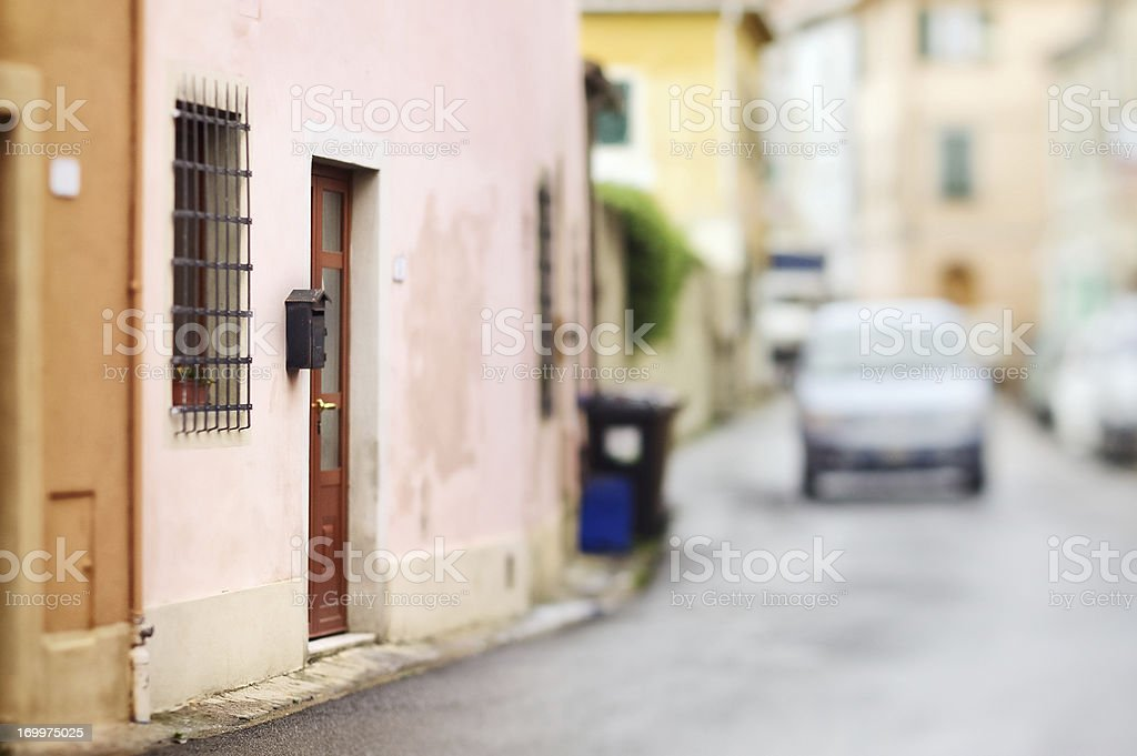 Typical Italian village street with unrecognizable car royalty-free stock photo