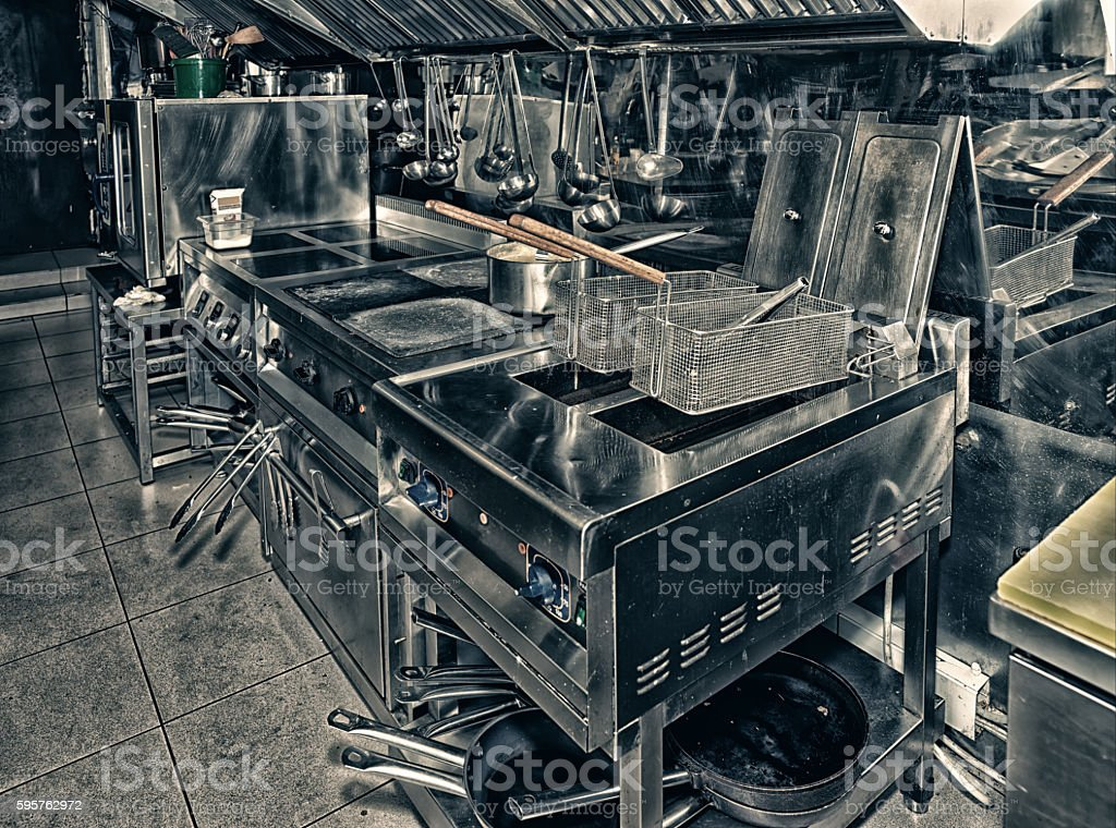 Typical kitchen of a restaurant, toned stock photo
