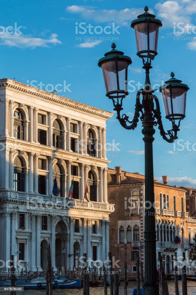 Typical Lamp, Facades and Grand Canal in a Summer Day in Venice, Italy stock photo