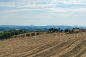 Typical landscape in Tuscany, farmhouse on hills of Val d'Or