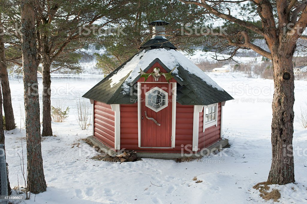 Typical Lappland hut under trees in snow royalty-free stock photo