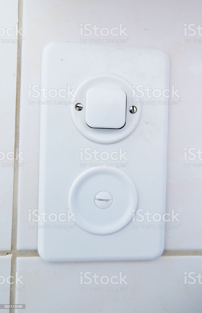 Typical light switch in Switzerland stock photo
