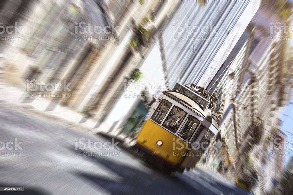 Typical Lisbon road with a yellow tram royalty-free stock photo