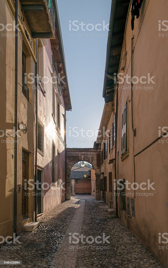 Typical little street of the medieval town of Soave, Italy. stock photo