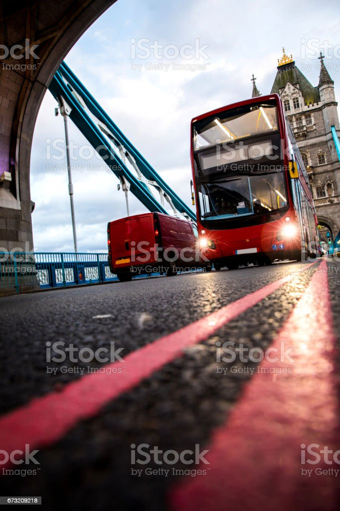 Typical London double decker red bus on Tower Bridge stock photo