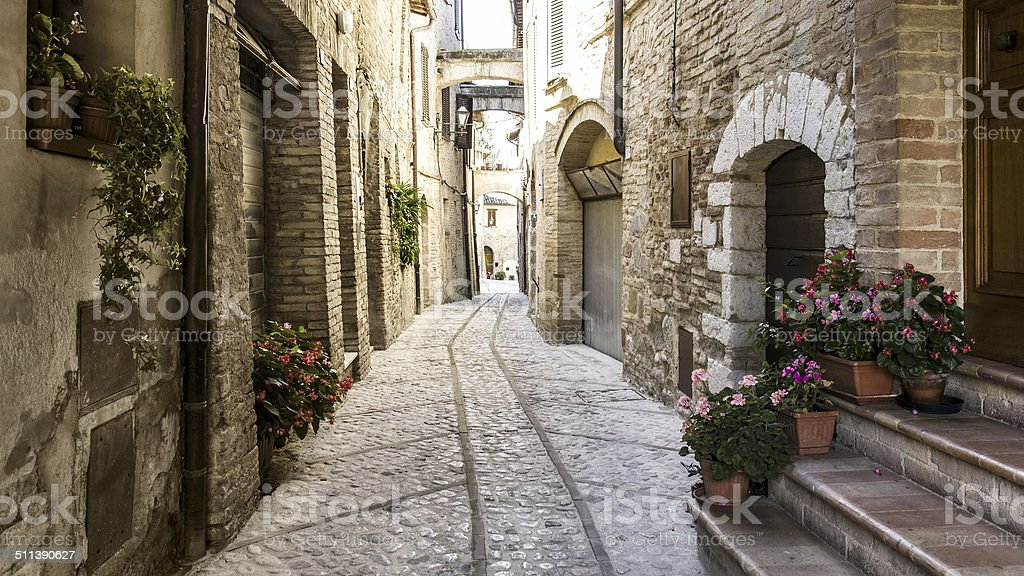 Typical medieval street in Italy stock photo