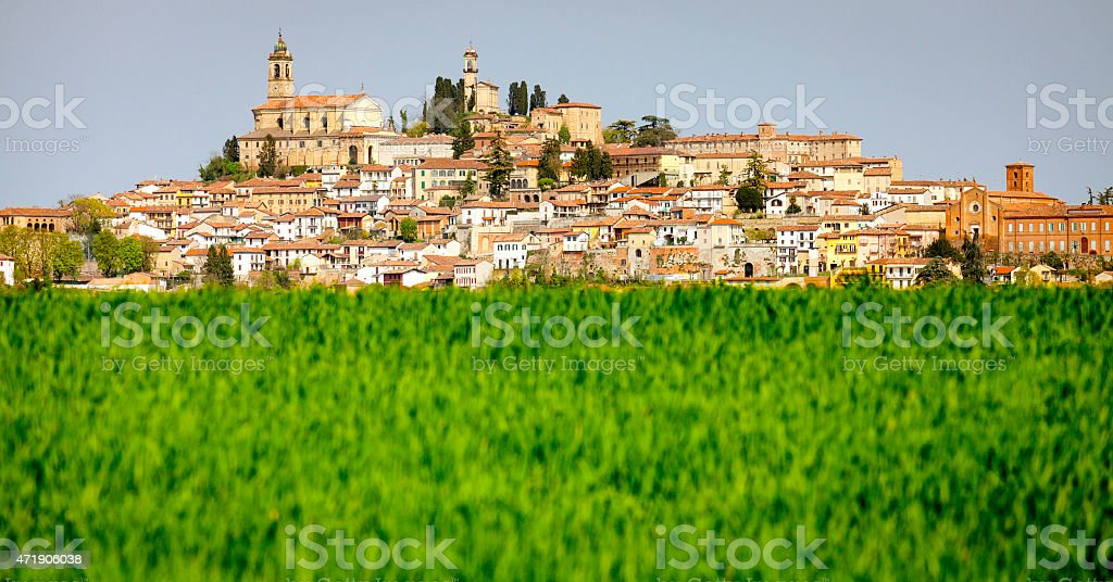 Typical Monferrato village, behind a meadow . Color image stock photo