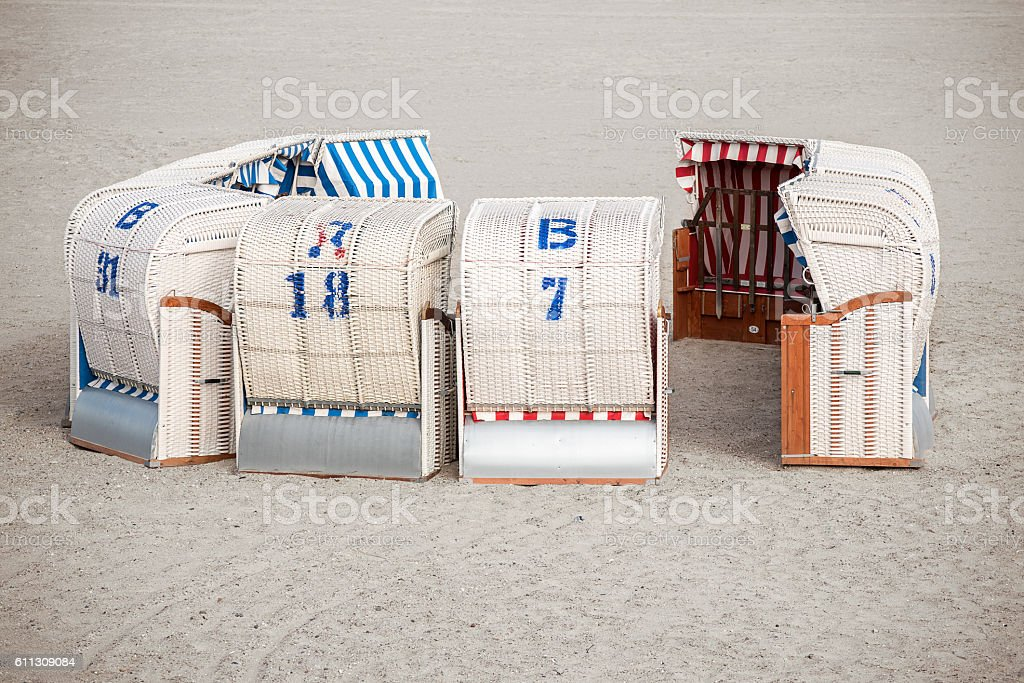 typical Northern German beach chairs, called Strandkorb stock photo