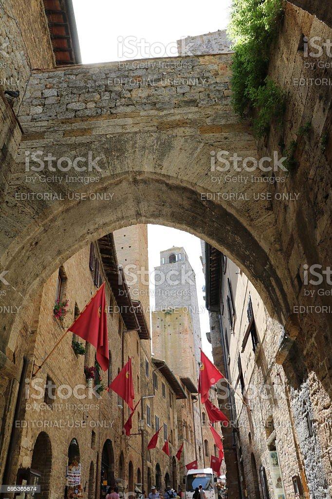 Typical old narrow archway in San Gimignano, Tuscany Italy stock photo