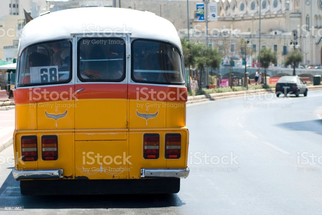 typical old yellow bus in malta along the street royalty-free stock photo