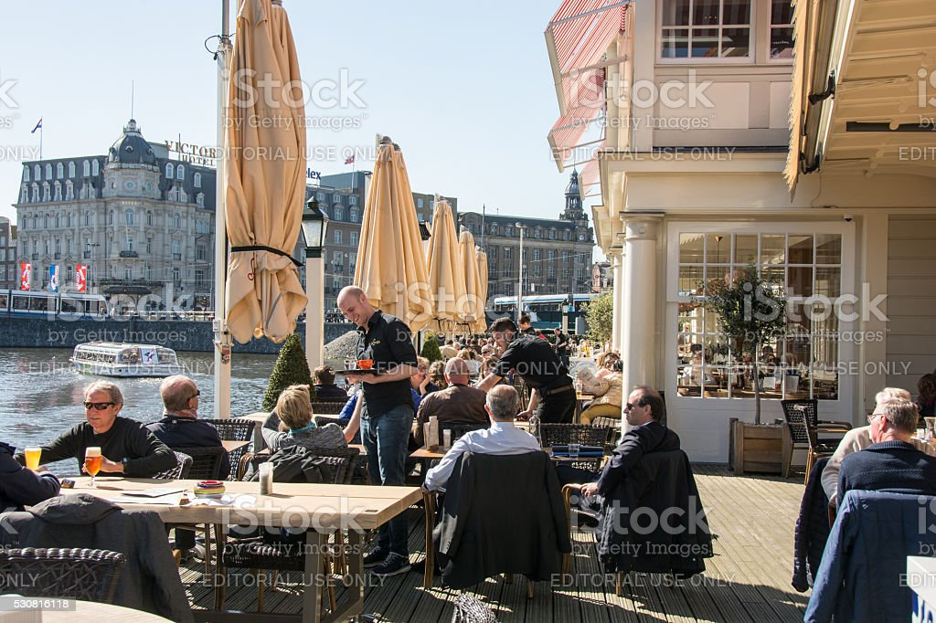 Typical outdoor Amsterdam cafe and coffee shop near train station stock photo