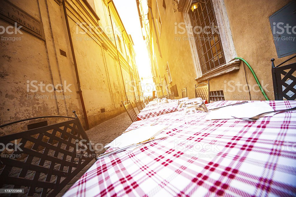 Typical outdoors restaurant in Rome alley royalty-free stock photo