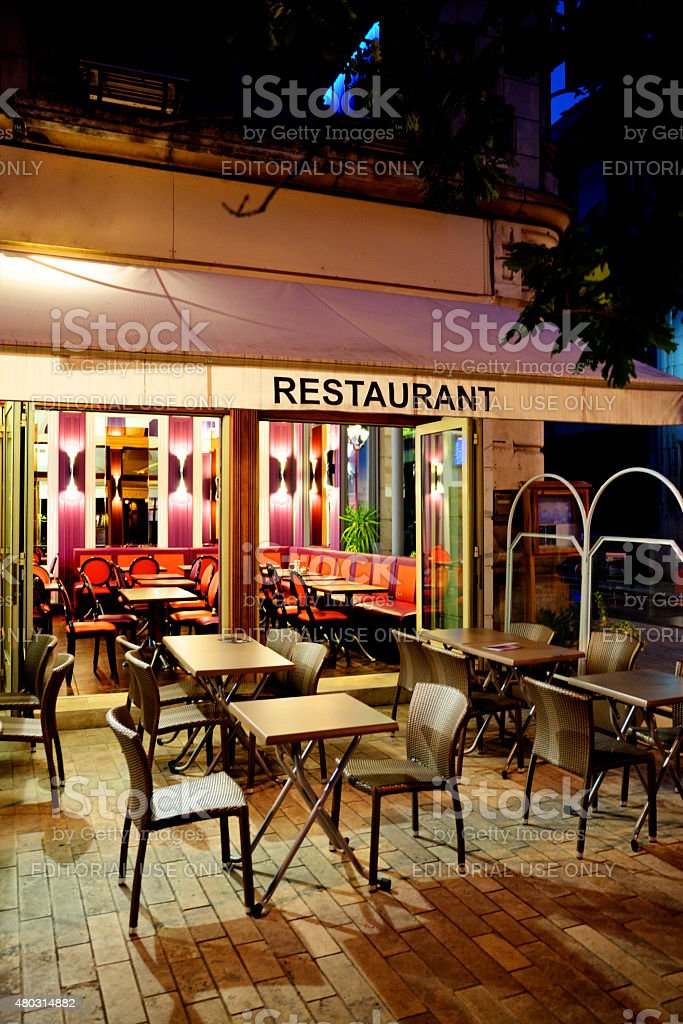 Typical outside French restaurant on cobblestone street stock photo