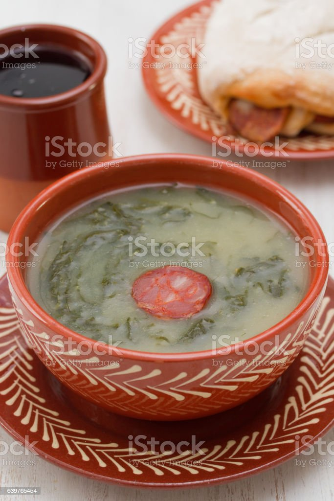 typical portuguese soup caldo verde with bread with smoked sausage stock photo