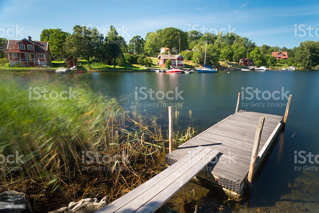 Typical red and yellow Sweden houses and boats stock photo