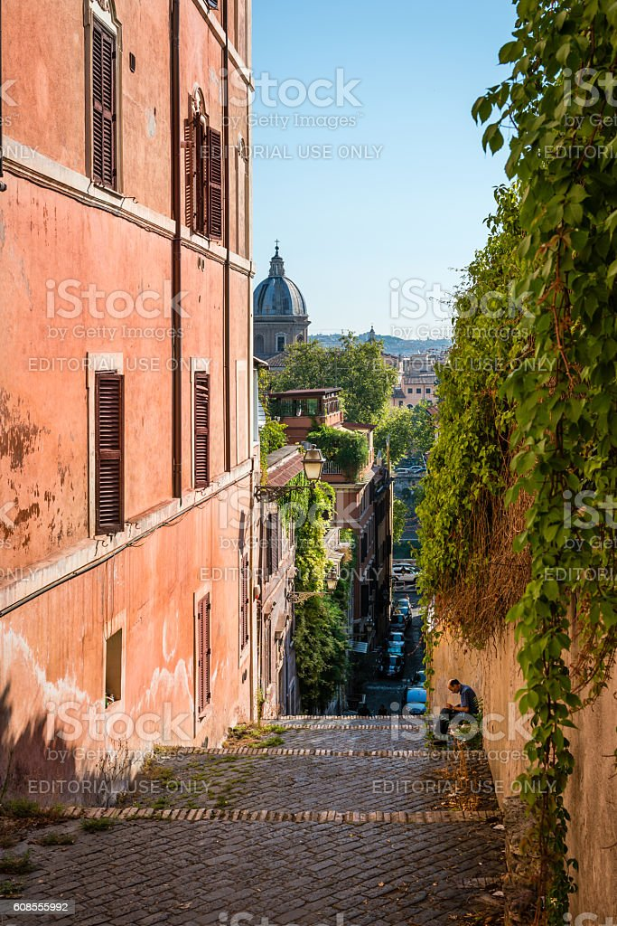 Typical Roman urban panorama, church, red plaster buildings stock photo