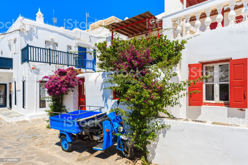 Typical small vehicle for carrying supplies to shops and bars parked on street in Mykonos town, Greece stock photo