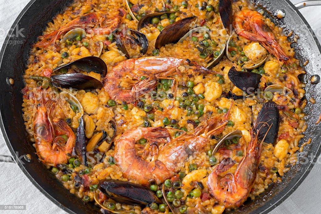 Typical Spanish paella with monkfish and shellfish