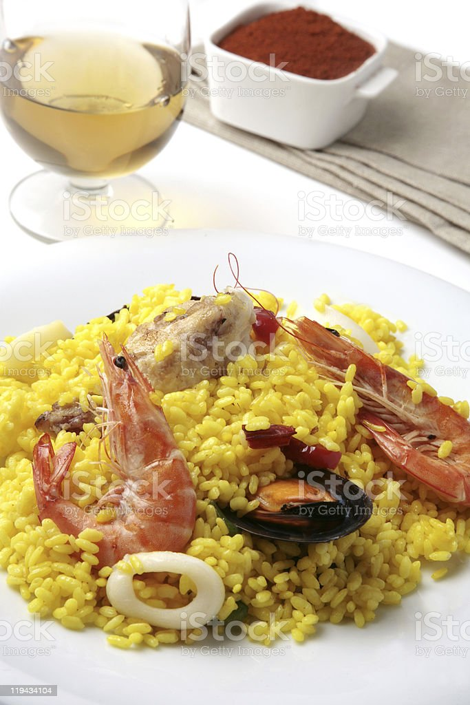 typical spanish seafood and chicken paella royalty-free stock photo