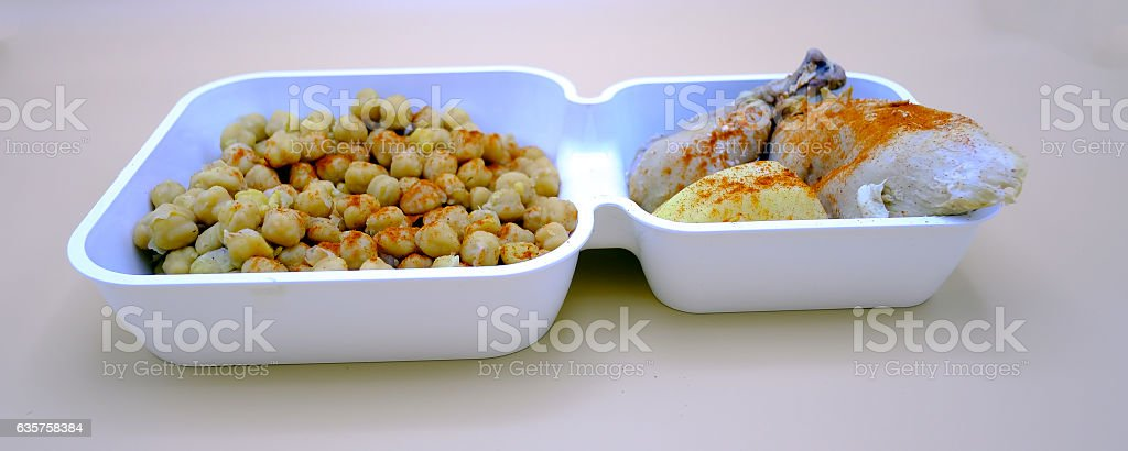 Typical Spanish stew of chickpeas with chicken and potatoes. stock photo