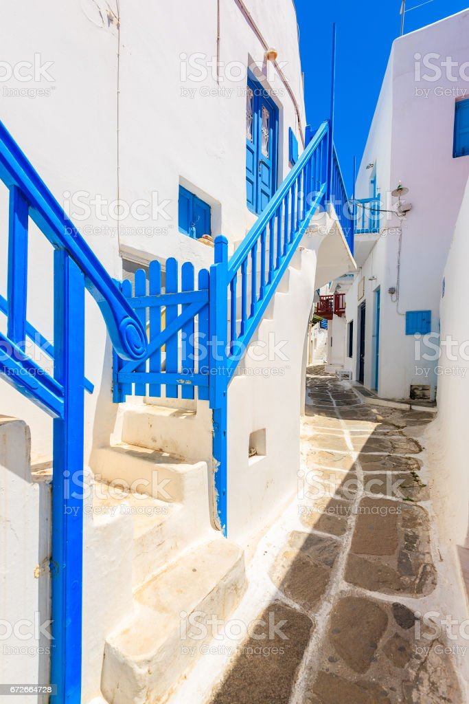Typical street of beautiful Mykonos town with white and blue Greek architecture, Cyclades islands, Greece stock photo