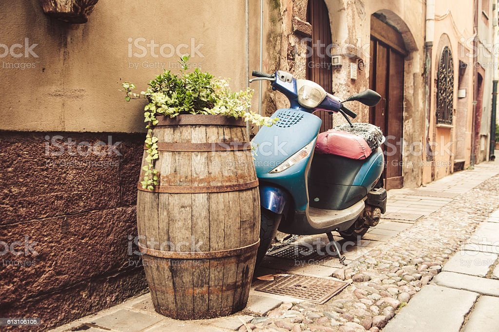 typical street scene with old scooter in Italy stock photo