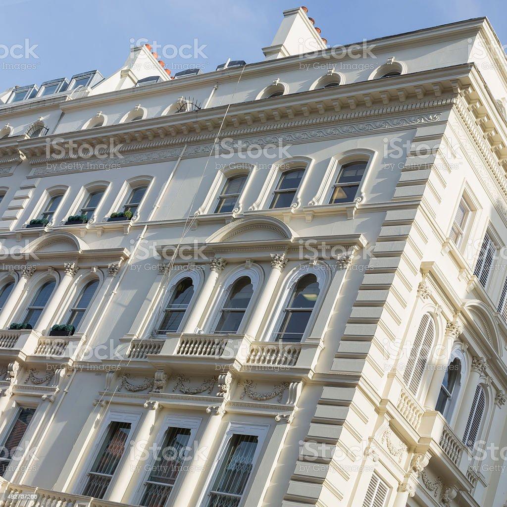 Typical stuccoed terrace house facade stock photo
