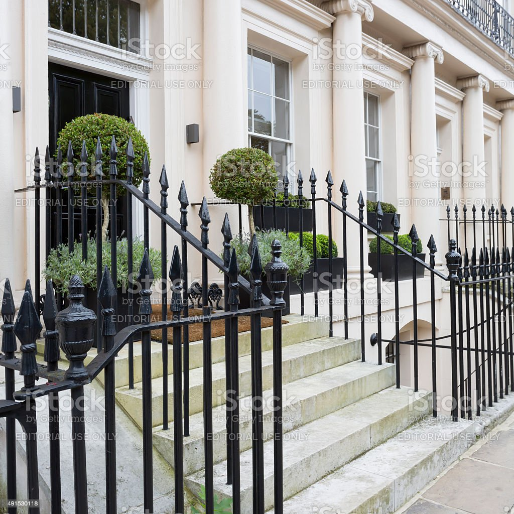 Typical stuccoed terraced houses detail stock photo